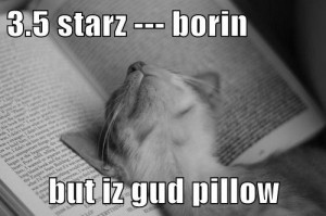 Kitteh sleeping on book - 3.5 starz - borin but iz gud pillow