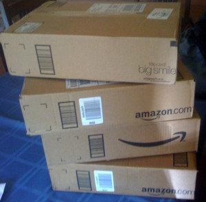 A stack of 4 Amazon boxes. Credit: scriptingnews on Flickr